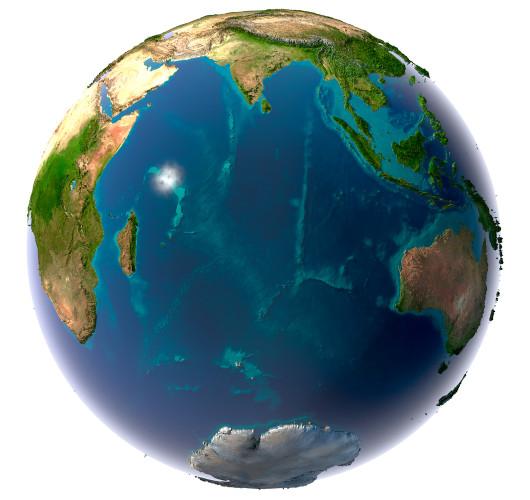 Planeta Terra com topografia detalhada dos continentes, com o oceano Índico ao centro.