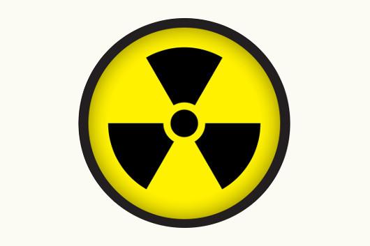 Símbolo que indica que em determinada área existe radiação